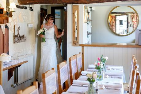 the bride enters the dining room at cley windmill