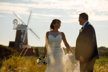 bride and groom with the windmill in the background