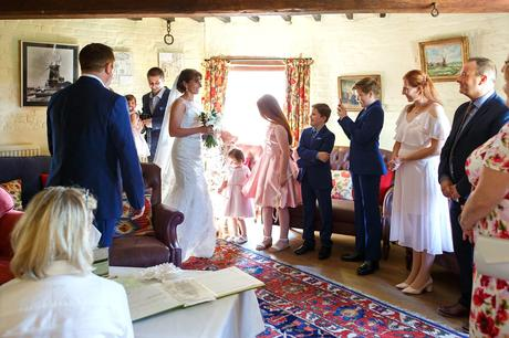 the bride enters the ceremony room for her north norfolk wedding