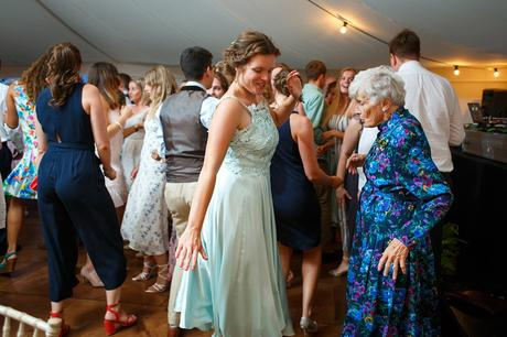 the brides sister dancing with her grandmother
