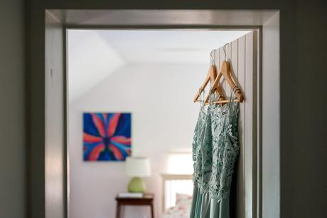 bridesmaid dresses hanging in a doorway