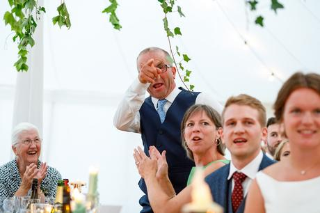 the father of the groom reacts to the father of the brides speech