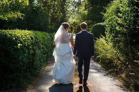 bride and groom walking in the lane