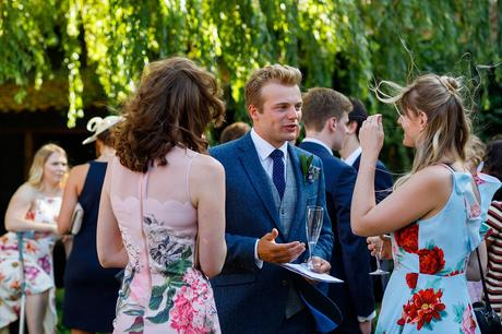 wedding guests talking in the garden