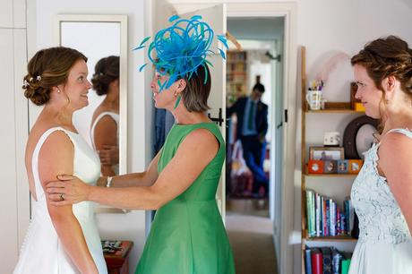 esther and her mother share a moment during the bridal preparations