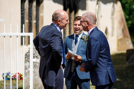 the grooms father and ushers laugh