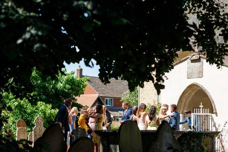 guests arrive at old buckenham church