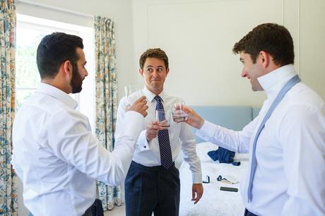 the groom toasts his groomsmen