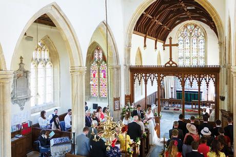 a wedding ceremony inside pennard church