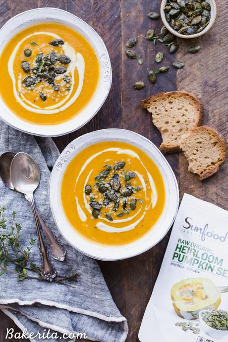 This Butternut Squash Soup is smooth, brightly flavored, and swirled with an easy cashew cream. It's topped off with crunchy spiced pumpkin seeds. This paleo and vegan soup is perfect for chilly days and best served with some crusty gluten-free bread!