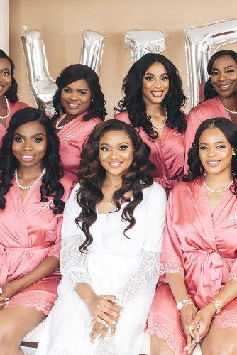 real wedding cindy glen black bride with loose curls and bridesmaids in pink robes before the wedding stanlo photography