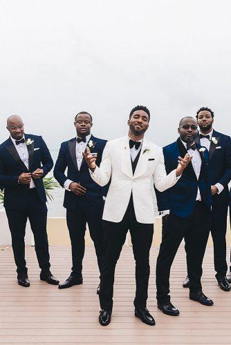 real wedding cindy glen black groom and his best mans in dark blue suits stanlo photography