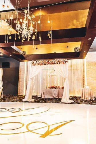 real wedding photography cindy glen wedding reception hall with flower arch stanlo photography