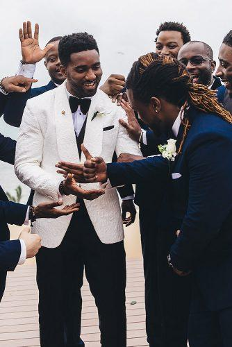 real wedding cindy glen black groom best men congratulate the groom stanlo photography