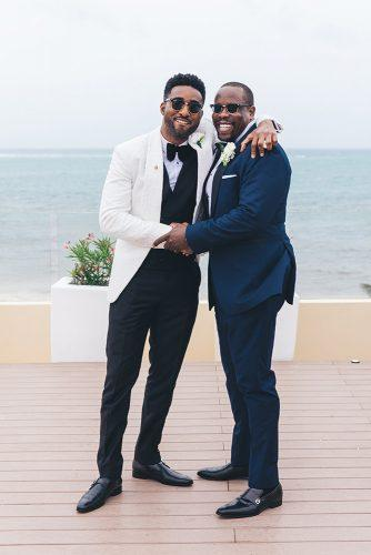 real wedding cindy glen black groom in black white suit and best man in sun glasses stanlo photography