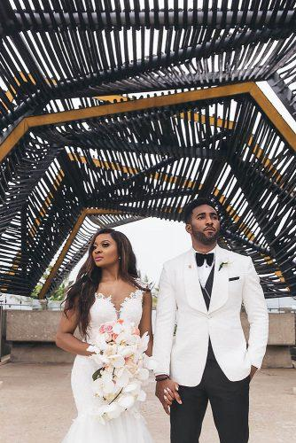 real wedding photography cindy glen photo bride with loose curls in lace dress with cascading orchid groom in white black suit stanlo photography