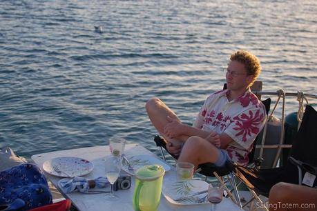 Jamie sits in a collapsible chair on the aft deck of a boat