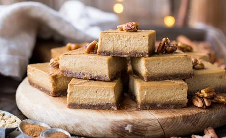 "With an easy pecan-and-date crust and tons of warm spices, these Gingerbread Cheesecake Bars are packed with the holiday season's warm flavors. These ""cheesecake"" bars are made with soaked cashews to replicate cheesecake's creamy texture—no dairy or baking necessary. You won't miss the dairy one bit in these gluten-free, vegan bars."