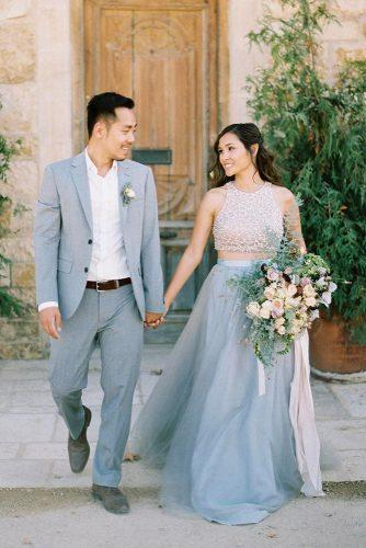 wedding colors 2019 groom in gray suit and bride with half up half down hairstyle in skirt katiegrantphoto