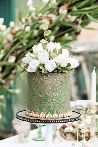 wedding colors 2019 olive green and gold small cake with white flowers on top helenwarnerphotography