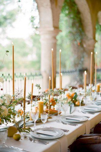 wedding colors 2019 mustard yellow centerpieces with candles and flowers on long table jose villa