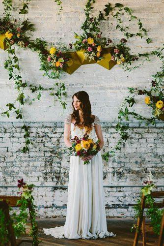 wedding colors 2019 mustard yellow flowers on wedding backdrop and bridal bouquets redfield photo