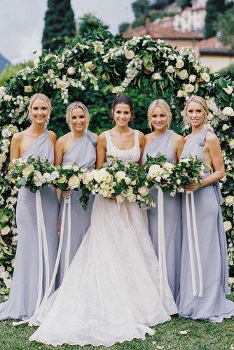 wedding colors 2019 bride and bridesmaids in gray dresses with white and greenery wedding bouquets katiegrantphoto