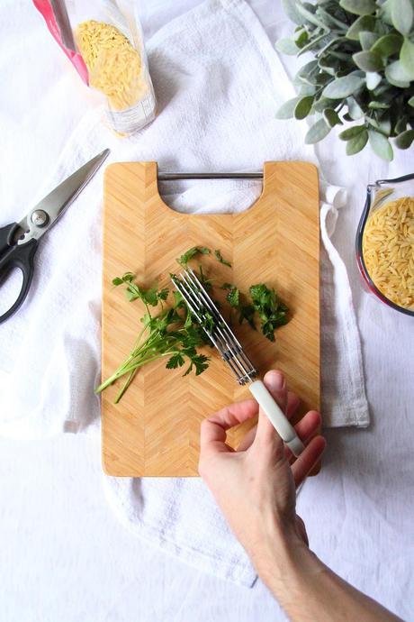 Using herb scissors to cut herbs