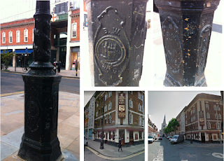 Brushfield Street, Spitalfields. A large lamp post and a pastiche pub.