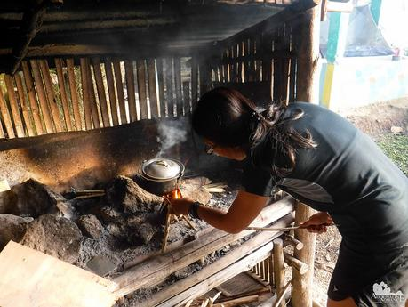 Cooking rice in a wooden stove