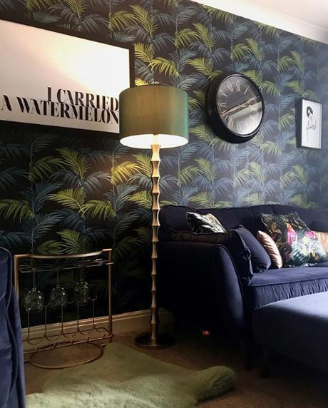 Moody living room with tropical wallpaper and drinks table by Audenza. Image by @vic_at_number_46