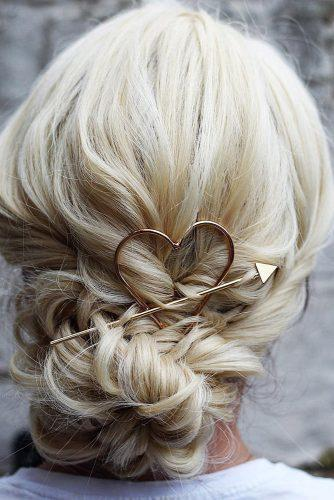 valentines day hairstyles simple low bun with heart and arrow gold metallic hairpin theupdogirl