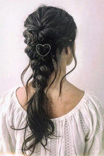 valentines day hairstyles braid down on dark haie with swept and curls metallic heart pin cruzmakeup