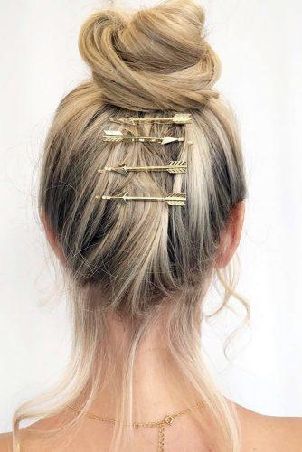 valentines day hairstyles high bun with gold arrows hairpin adina_pignatare