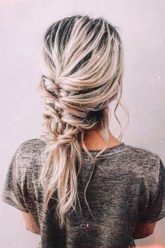 valentines day hairstyles messy braid with loose curls on medium blonde hair cruzmakeup