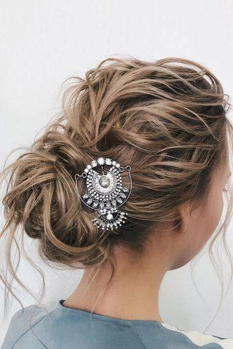 valentines day hairstyles wavy updo with loose curls and ethnic pin belaya_lyudmila