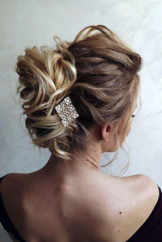 valentines day hairstyles wavy updo with ethniv metallic pin nastya_kopach