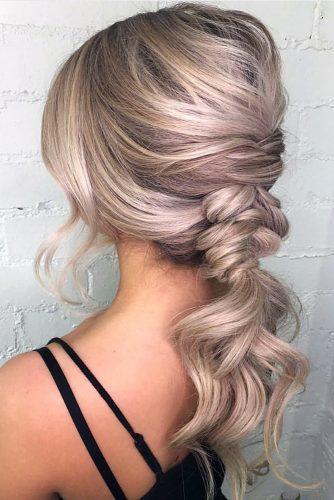 valentines day hairstyles stylish blonde ponytail braided with soft waves on blonde hair raehairstylist