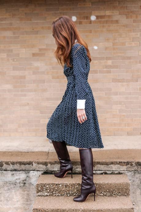 Amy Havins wears a navy polka dot dress