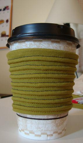 Reusable coffee sleeve with pintucking