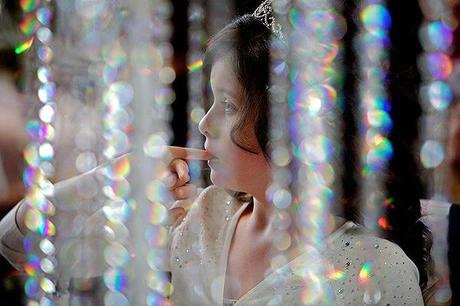 young girl at a wedding with sparkles
