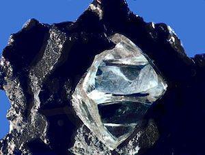 Nearly octahedral diamond crystal in matrix.