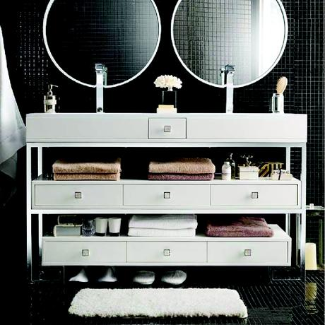 simple all white double sink standing vanity with cubby space and drawers