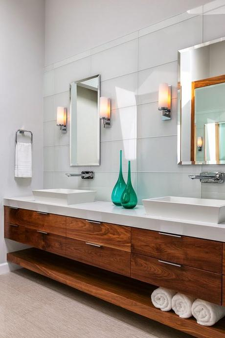white bathroom with natural wood bathroom vanity with two vessel sinks