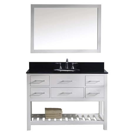 simple modern farmhouse bathroom vanity with black top and white wood finish