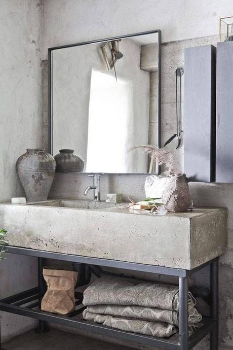 simple single sink modern bathroom vanity with concrete counter and black metal base