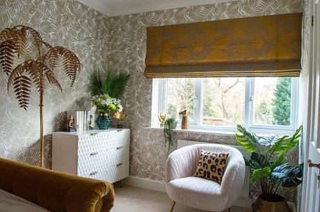 Glam and feminine bedroom with blush pink velvet armchair.
