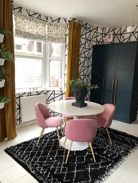 Monochrome and pink kitchen inspiration with geometric wallpaper.