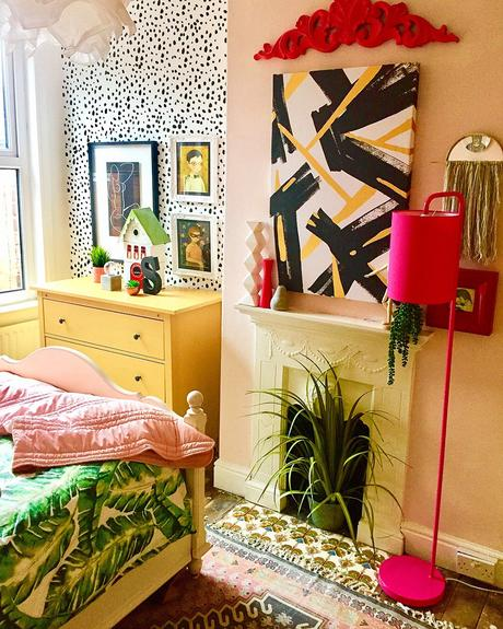 Colourful and fun bedroom with clashing patterns.