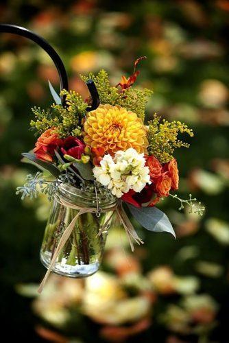 park wedding orange flower in jar Melanie Duerkopp-Johnson Photography